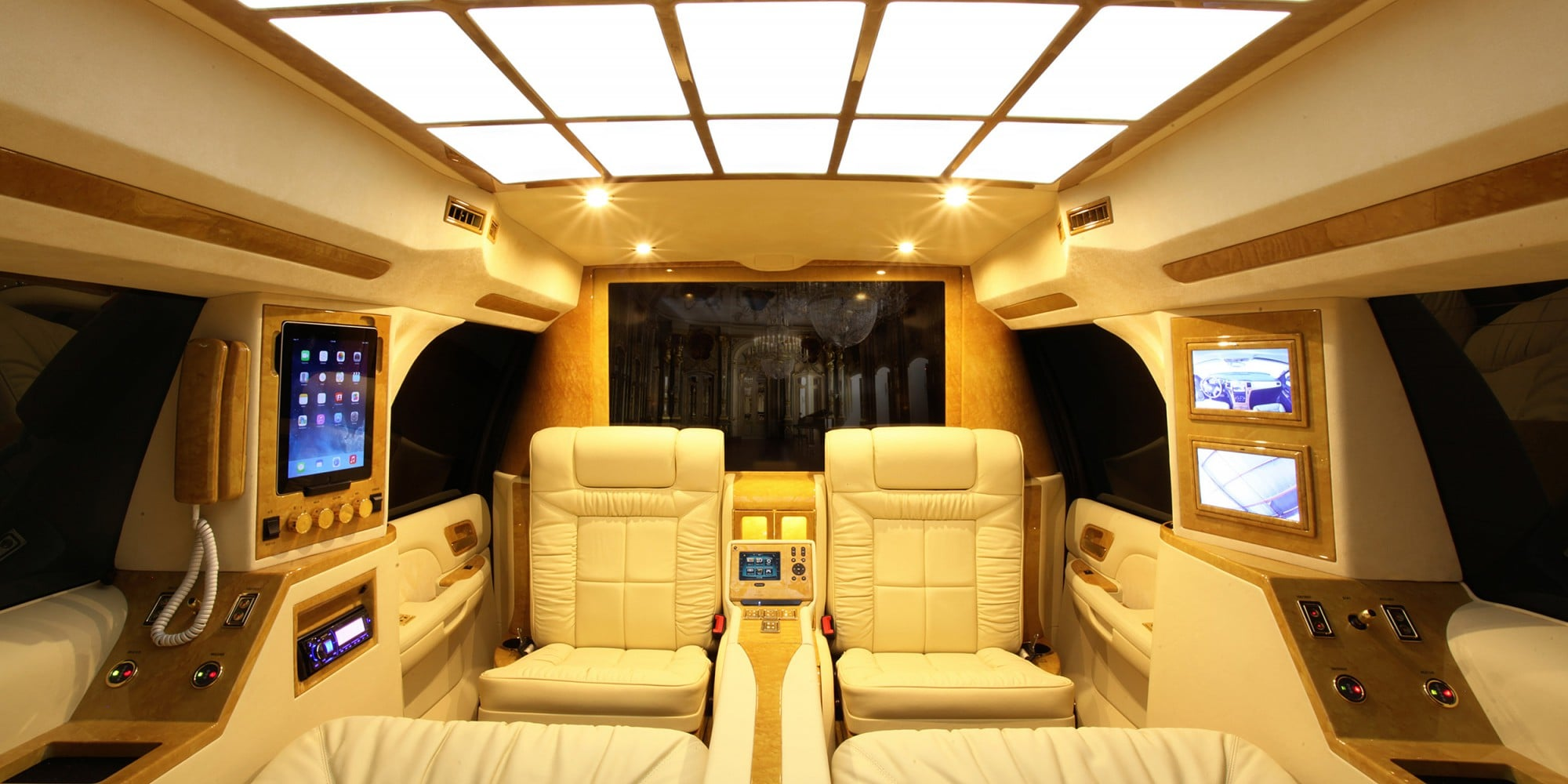 Lexani Motorcars luxury white leather and wood finish interiors
