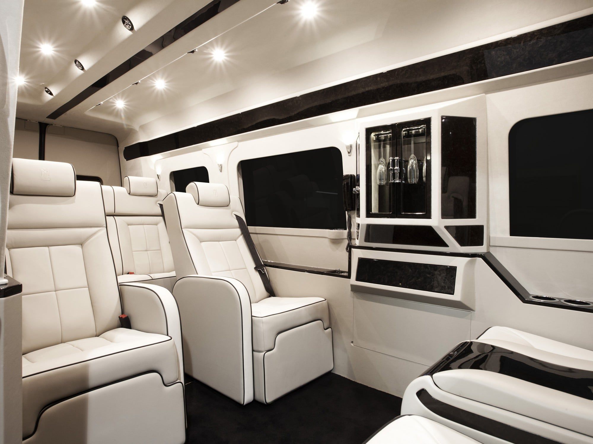 Lexani Motorcars white leather and black marble finish luxury interior