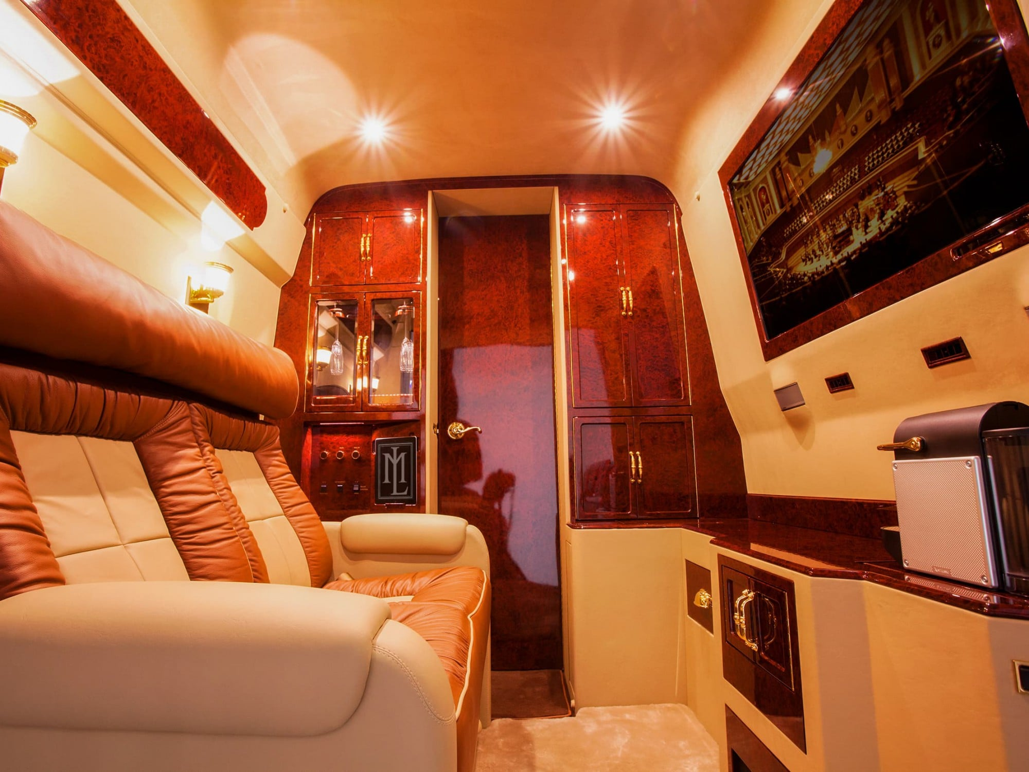 Lexani Motorcars luxury VIP room/private entertainment area vehicle conversion